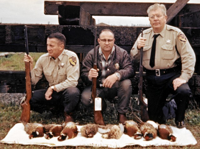 PheasantsConfiscated_1967WallyCalan_USFWSagentBobNorris_WardenHaroldErwick